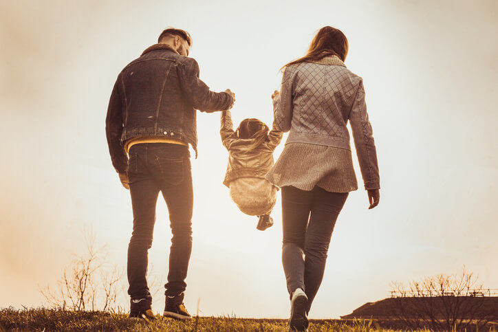Parents Carying Child
